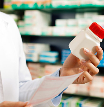 Pharmacist holding prescription bottle on walk in clinic page
